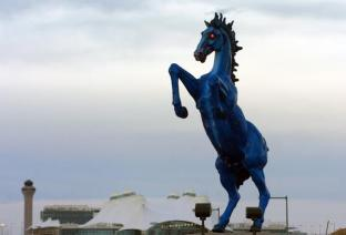 """(JS) ABOVE: A 32-foot sculpture commissioned three years before Denver International Airport opened was finally installed in the median of Pena Boulevard leading up to the terminal. """"Mustang"""" was bolted onto a concrete base. Creation of the sculpture survived lawsuits over the pace of the work, the illness of sculptor Luis Jimenez, and his death when a section of the sculpture came loose from a hoist and pinned him against a steel support beam. Jimenez was 65 when he died at his Hondo, N.M., studio in June 2006. His family, including sons Adan and Orion, finished the sculpture, his widow Susan Jimenez said. Helen H. Richardson/The Denver Post"""